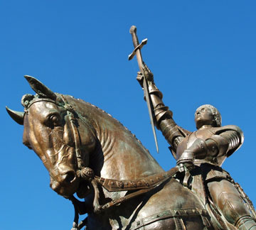 Statue of Joan of Arc on horseback holding sword